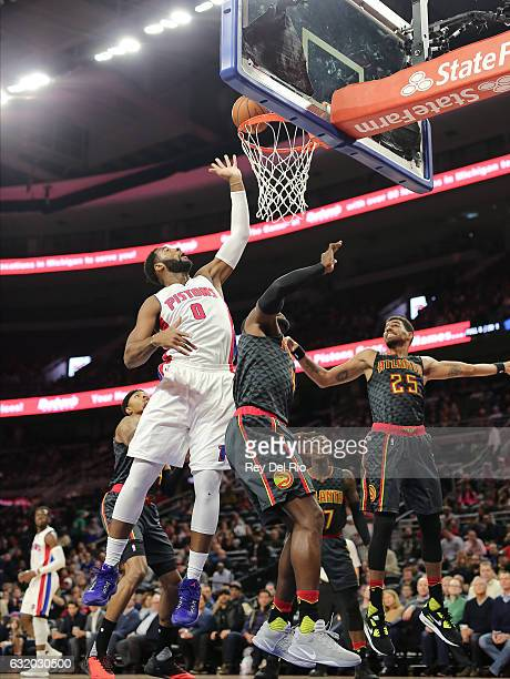 Andre Drummond of the Detroit Pistons shoots over Paul Millsap of the Atlanta Hawks at the Palace of Auburn Hills on January 18 2017 in Auburn Hills...