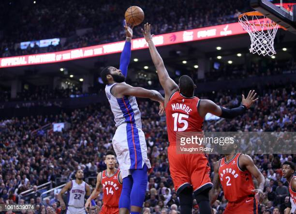 Andre Drummond of the Detroit Pistons shoots the ball as Greg Monroe of the Toronto Raptors defends during the first half of an NBA game at...