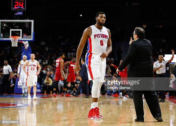 Andre Drummond of the Detroit Pistons talks with head coach Stan Van Gundy while playing the Miami Heat at the Palace of Auburn Hills on April 12...