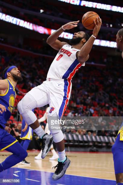 Andre Drummond of the Detroit Pistons tries to get a shot off next to JaVale McGee of the Golden State Warriors during the second half at Little...