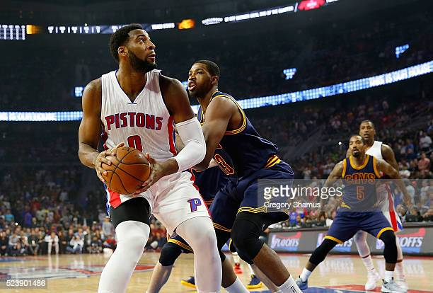 Andre Drummond of the Detroit Pistons tries to make a move around Tristan Thompson of the Cleveland Cavaliers in the first quarter of game four of...