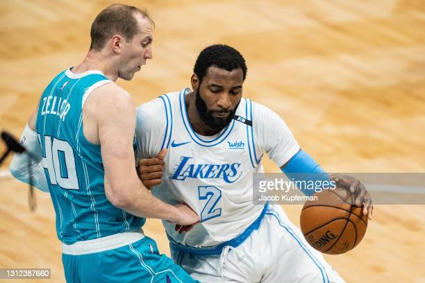 Andre Drummond of the Los Angeles Lakers fouls Cody Zeller of the Charlotte Hornets in the second quarter during their game at Spectrum Center on...