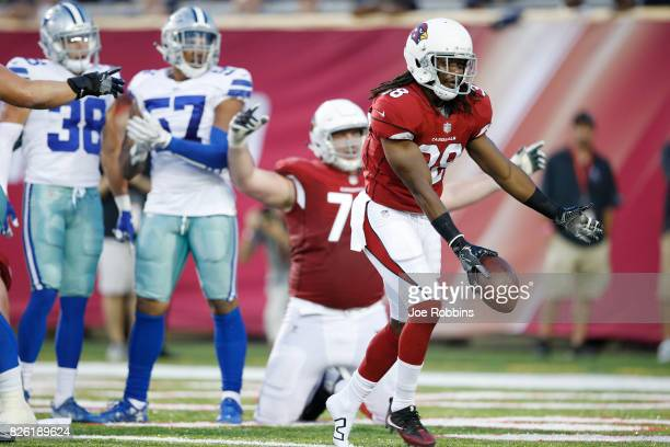Andre Ellington of the Arizona Cardinals celebrates after rushing for a threeyard touchdown in the first quarter of the NFL Hall of Fame preseason...