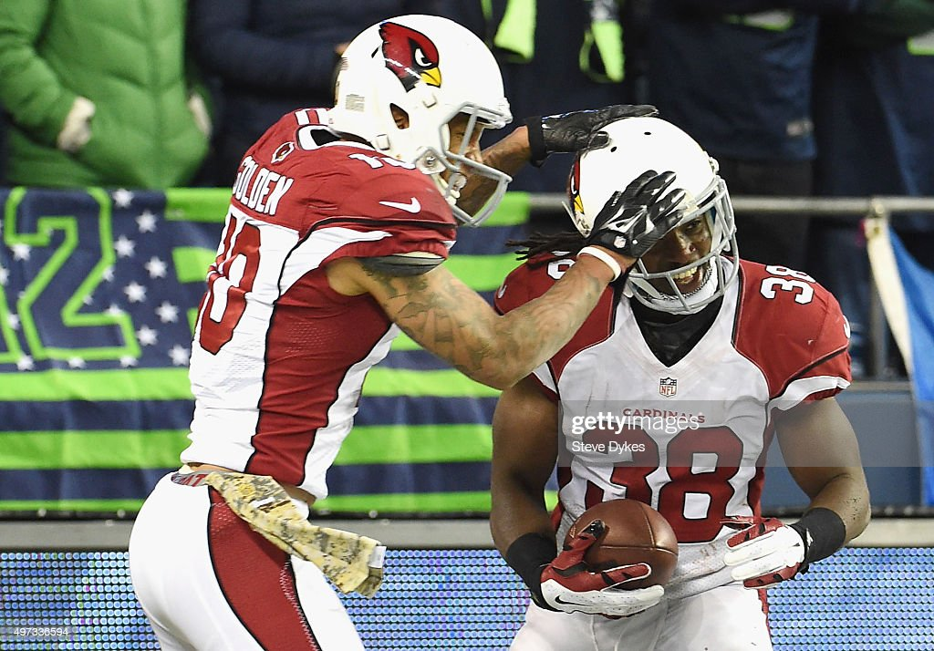 Andre Ellington #38 of the Arizona Cardinals celebrates with Brittan Golden #10 of the Arizona Cardinals in the end zone after rushing for a 48-yard touchdown during the fourth quarter against the Seattle Seahawks at CenturyLink Field on November 15, 2015 in Seattle, Washington.