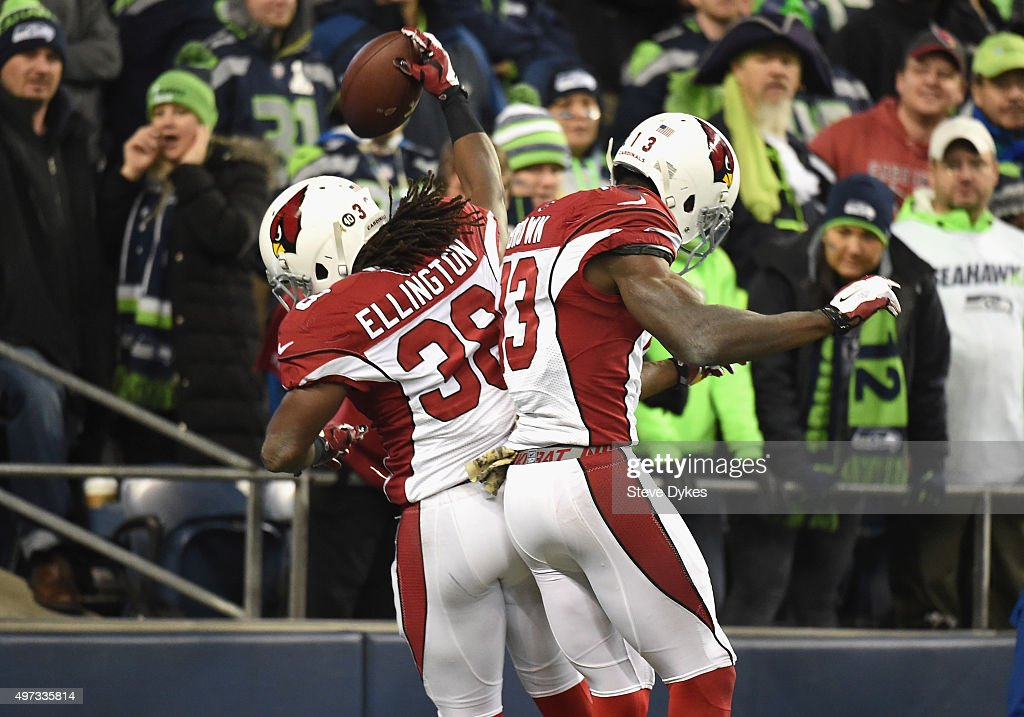 Andre Ellington #38 of the Arizona Cardinals celebrates with Jaron Brown #13 of the Arizona Cardinals in the end zone after rushing for a 48-yard touchdown during the fourth quarter against the Seattle Seahawks at CenturyLink Field on November 15, 2015 in Seattle, Washington.