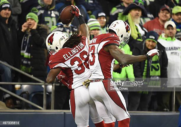 Andre Ellington of the Arizona Cardinals celebrates with Jaron Brown of the Arizona Cardinals in the end zone after rushing for a 48yard touchdown...