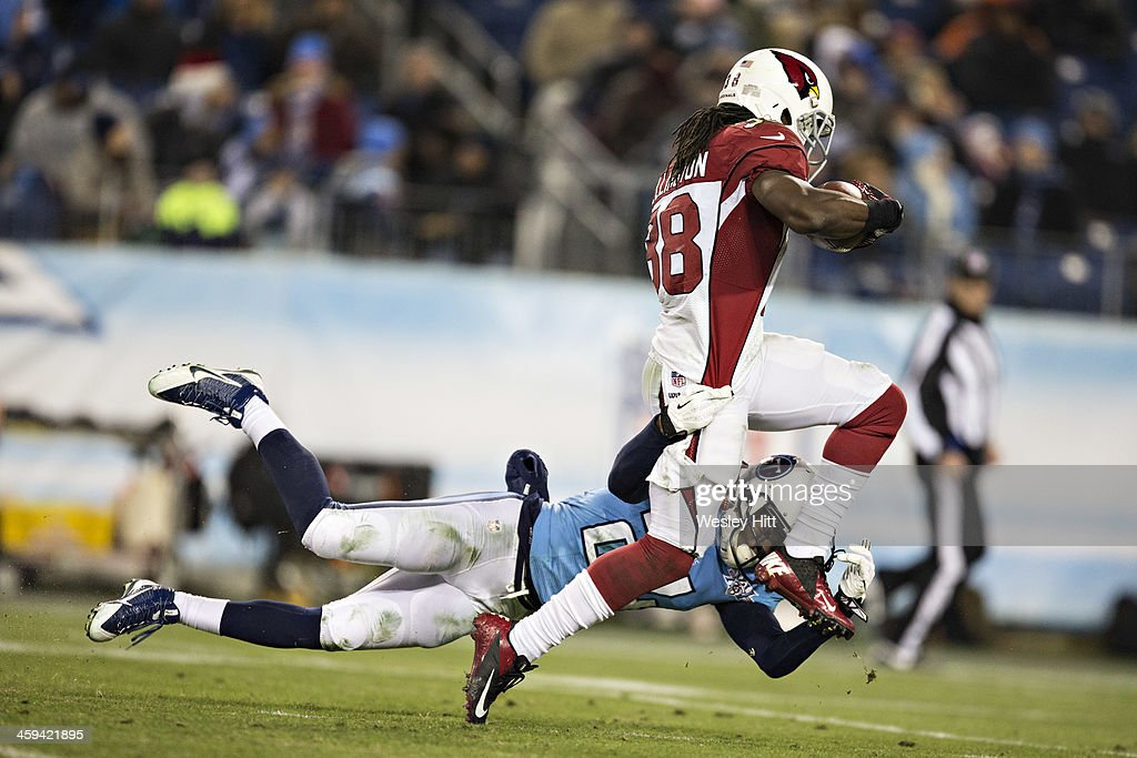 Andre Ellington #38 of the Arizona Cardinals is tackled by Coty Sensabaugh #24 of the Tennessee Titans at LP Field on December 15, 2013 in Nashville, Tennessee. The Cardinals defeated the Titans 37-34.