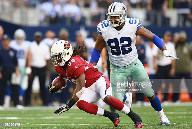 Andre Ellington of the Arizona Cardinals runs the ball against Jeremy Mincey of the Dallas Cowboys in the second quarter at ATT Stadium on November 2...