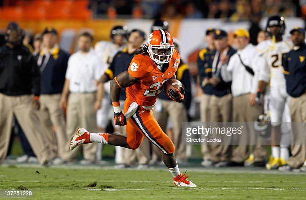 Andre Ellington of the Clemson Tigers runs the ball against the West Virginia Mountaineers during the Discover Orange Bowl at Sun Life Stadium on...