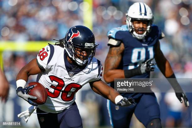 Andre Ellington of the Houston Texans runs with the ball after a reception against the Tennessee Titans during the first half at Nissan Stadium on...