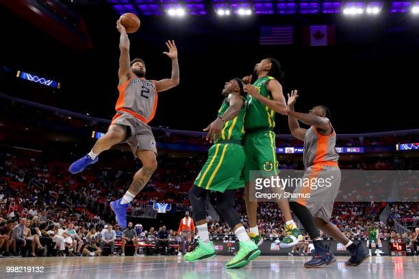 Andre Emmett of 3's Company attempts a shot past DeShawn Stevenson and Josh Childress of the Ball Hogs during BIG3 Week Four at Little Caesars Arena...
