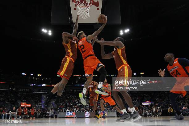 Andre Emmett of 3's Company carries the ball as Josh Smith of Bivouac and C.J. Leslie of Bivouac during the BIG3 Playoffs at Smoothie King Center on...