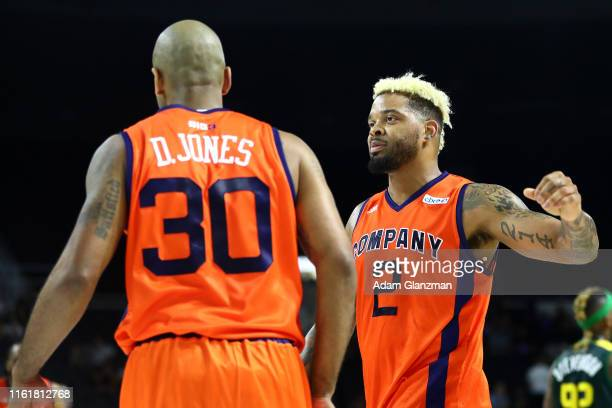 Andre Emmett of 3's Company celebrates with Dahntay Jones against the Ball Hogs during week four of the BIG3 three on three basketball league at...