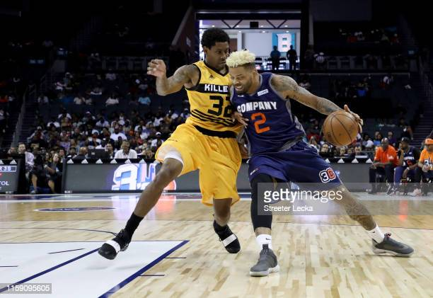 Andre Emmett of 3's Company drives to the basket against C.J. Watson of Killer 3s during week two of the BIG3 three on three basketball league at...