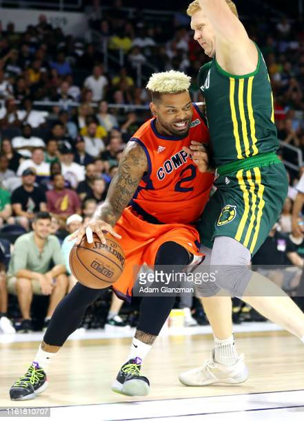 Andre Emmett of 3's Company handles the ball against the Ball Hogs during week four of the BIG3 three on three basketball league at Dunkin' Donuts...