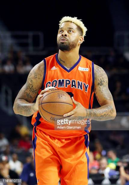 Andre Emmett of 3's Company shoots a free throw against the Ball Hogs during week four of the BIG3 three on three basketball league at Dunkin' Donuts...