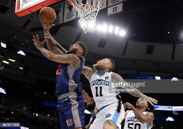 Andre Emmett of 3's Company shoots against Chris Andersen of Power during week two of the BIG3 three on three basketball league at United Center on...
