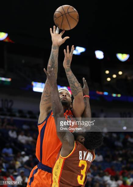 Andre Emmett of 3's Company takes a shot as Will Bynum of Bivouac defends during the BIG3 Playoffs at Smoothie King Center on August 25, 2019 in New...