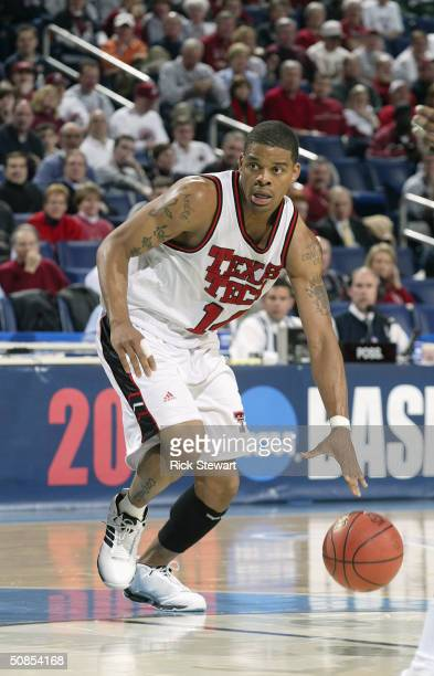 Andre Emmett of the Texas Tech Red Raiders moves the ball during the first round game of the 2004 NCAA Basketball Tournament against the Charlotte...