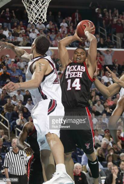 Andre Emmett of the Texas Tech University Red Raiders shoots against the St. Joseph's University Hawks during the second round of the NCAA Men's...