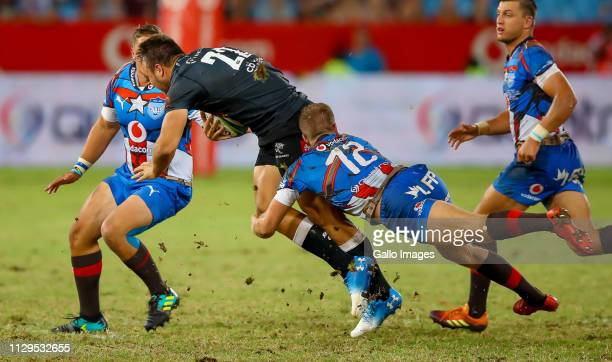 Andre Esterhuizen of the Cell C Sharks tackled and held by Dylan Sage of the Vodacom Bulls during the Super Rugby match between Vodacom Blue Bulls...