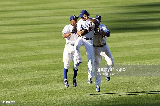 Andre Ethier Juan Pierre and Matt Kemp of the Los Angeles Dodgers celebrate after defeating the Philadelphia Phillies 21 in Game Two of the NLCS...