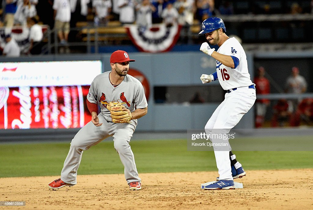 Andre Ethier #16 of the Los Angeles Dodgers celebrates after hitting a double in the ninth inning against the St. Louis Cardinals during Game One of the National League Division Series at Dodger Stadium on October 3, 2014 in Los Angeles, California.