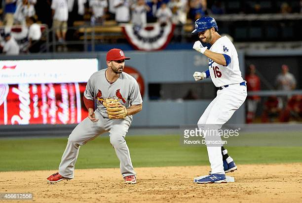 Andre Ethier of the Los Angeles Dodgers celebrates after hitting a double in the ninth inning against the St Louis Cardinals during Game One of the...