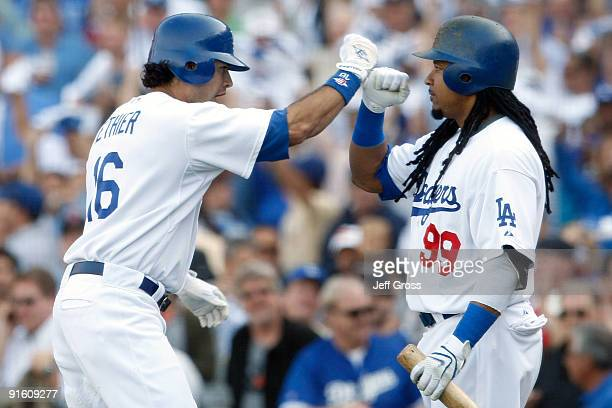 Andre Ethier of the Los Angeles Dodgers celebrates with Manny Ramirez after Ethier hit a solo home run to center in the fourth inning against the St...