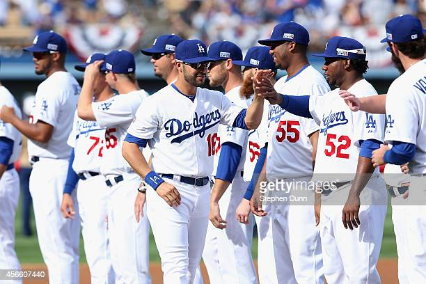 Andre Ethier of the Los Angeles Dodgers high fives teammates before playing in Game One of the National League Division Series against the St Louis...
