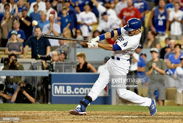 Andre Ethier of the Los Angeles Dodgers hits a a double in the ninth inning against the St Louis Cardinals during Game One of the National League...