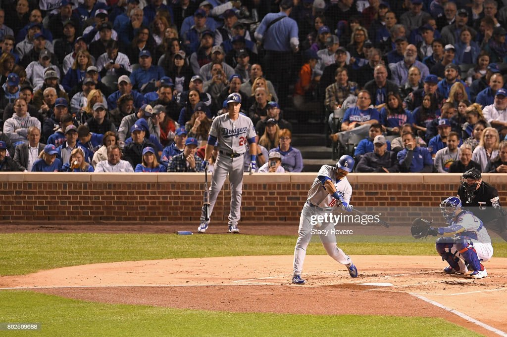 Andre Ethier #16 of the Los Angeles Dodgers hits a home run in the second inning against the Chicago Cubs during game three of the National League Championship Series at Wrigley Field on October 17, 2017 in Chicago, Illinois.