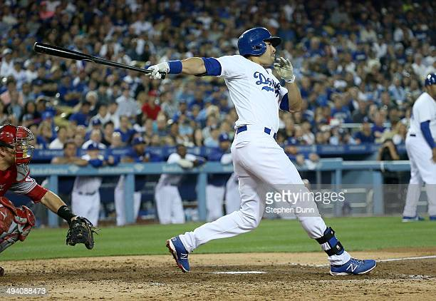 Andre Ethier of the Los Angeles Dodgers hits a three run triple in the fourth inning against the Cincinnati Reds at Dodger Stadium on May 27 2014 in...