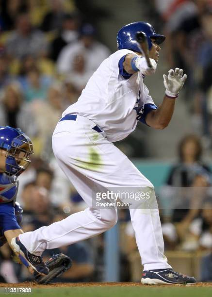 Andre Ethier of the Los Angeles Dodgers hits an RBI infield single in the fifth inning against the Chicago Cubs to extend his consecutive game...