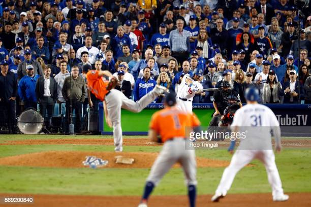 Andre Ethier of the Los Angeles Dodgers hits an RBI single in the sixth inning during Game 7 of the 2017 World Series against the Houston Astros at...