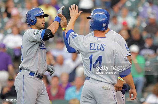 Andre Ethier of the Los Angeles Dodgers is welcomed home by Matt Kemp of the Los Angeles Dodgers and Mark Ellis of the Los Angeles Dodgers who scored...