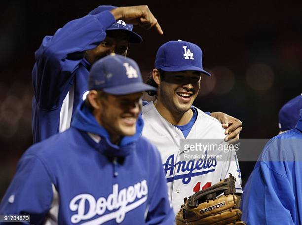 Andre Ethier of the Los Angeles Dodgers iscongratulated by teammates after their 51 victory of Game Three to win the NLDS after sweeping the St Louis...