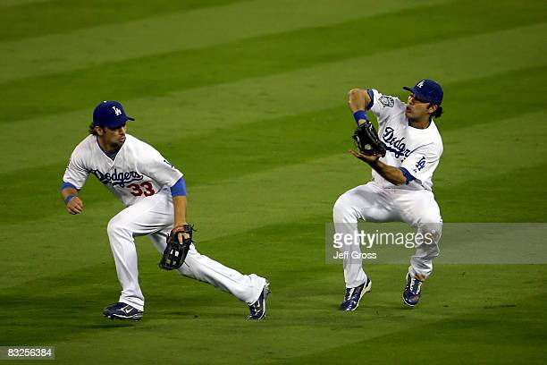 Andre Ethier of the Los Angeles Dodgers makes a catch in right field alongside teammate Blake DeWitt off a ball hit by So Taguchi of the Philadelphia...