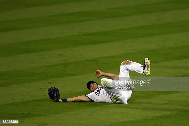 Andre Ethier of the Los Angeles Dodgers makes a catch in right field off a ball hit by So Taguchi of the Philadelphia Phillies with tworunners on in...