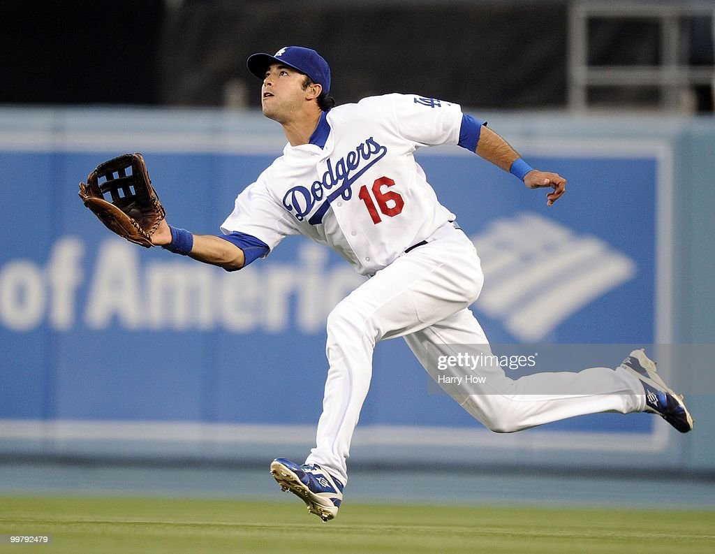 Andre Ethier #16 of the Los Angeles Dodgers makes a running catch for an out of Ian Stewart #9 of the Colorado Rockies during the second inning at Dodger Stadium on May 7, 2010 in Los Angeles, California.