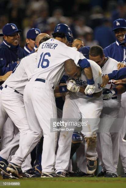 Andre Ethier of the Los Angeles Dodgers puts Matt Kemp in a headlock as the Dodgers celebrate at home plate after Kemp's walk off home run in the...