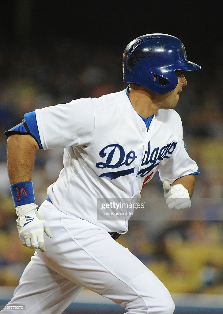 Andre Ethier #16 of the Los Angeles Dodgers runs to first base after hitting a single in the second inning against the Colorado Rockies at Dodger Stadium on April 29, 2013 in Los Angeles, California.