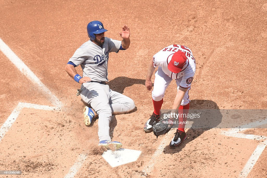 Andre Ethier #16 of the Los Angeles Dodgers scores on a Max Scherzer #31 of the Washington Nationals wild pitch in the forth inning during a baseball game at Nationals Park on July 19, 2015 in Washington, DC. The Dodgers won 5-0.