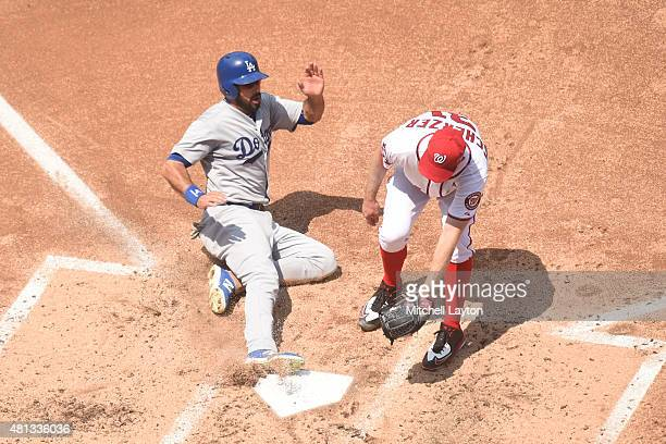 Andre Ethier of the Los Angeles Dodgers scores on a Max Scherzer of the Washington Nationals wild pitch in the forth inning during a baseball game at...