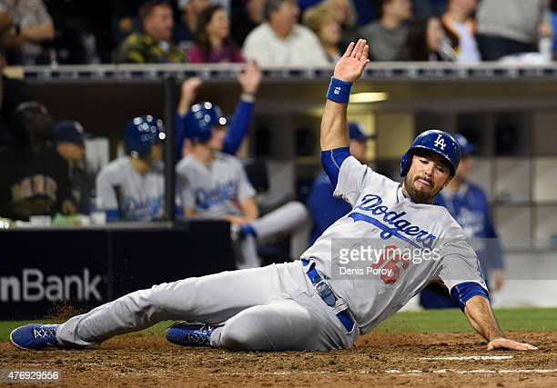Andre Ethier of the Los Angeles Dodgers slides as he scores during the eighth inning of a baseball game against the San Diego Padres at Petco Park...
