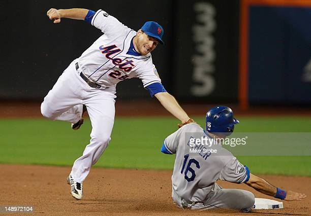 Andre Ethier of the Los Angeles Dodgers slides under the tag of Daniel Murphy of the New York Mets for a stolen base at Citi Field on July 20 2012 in...