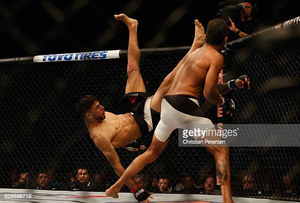 Andre Fili avoids a kick from Yair Rodriguez of Mexico in their featherweight bout during the UFC 197 event inside MGM Grand Garden Arena on April 23...