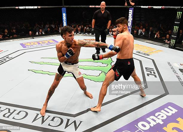 Andre Fili exchange punches with Yair Rodriguez of Mexico in their featherweight bout during the UFC 197 event inside MGM Grand Garden Arena on April...