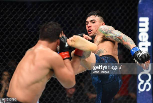 Andre Fili kicks Dennis Bermudez in their featherweight bout during a UFC Fight Night event at Spectrum Center on January 27 2018 in Charlotte North...