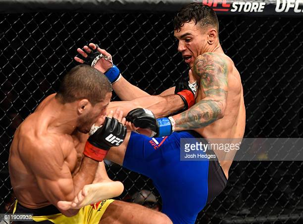 Andre Fili kicks Hacran Dias of Brazil in their featherweight bout during the UFC Fight Night event at the Moda Center on October 1 2016 in Portland...